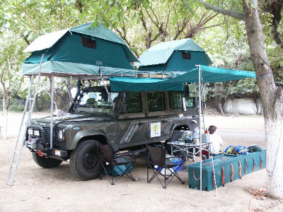 Of course Land Rovers and roof-tents go hand-in-hand & Roof tent car and van camping